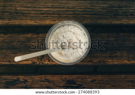 Coffee milkshake on a wooden bench, top view - stock photo