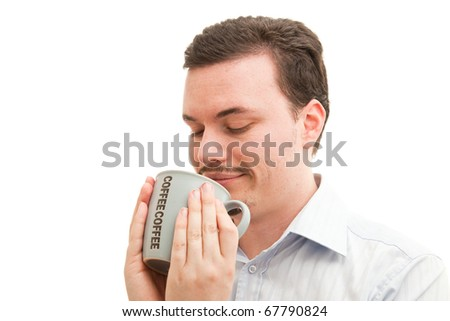 Coffee mug held contently by a caucasian male in a business shirt - stock photo