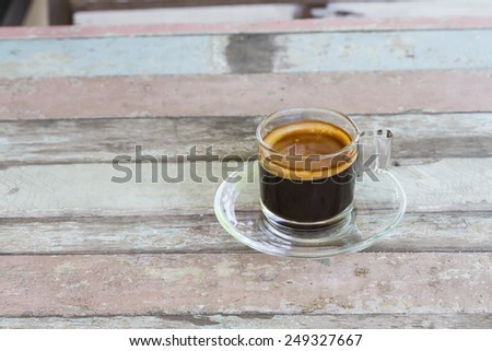 Coffee mug on old wooden table - stock photo