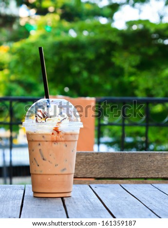 coffee on the wood garden table - stock photo