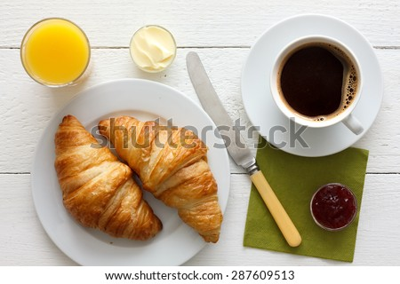Coffee, orange juice and croissant breakfast. From above. - stock photo
