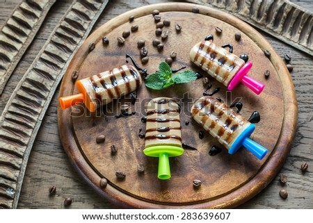 Coffee popsicles with chocolate topping - stock photo
