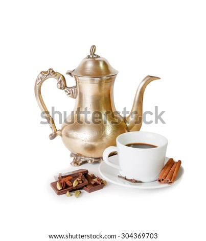 Coffee pot, cup of coffee with spices and pieces of chocolate isolated on white - stock photo
