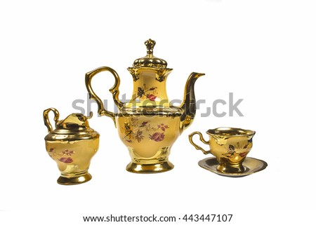 coffee pot maker cup jug porcelain yellow gold plated. - stock photo