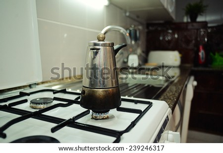 Coffee pot on a gas stove - stock photo