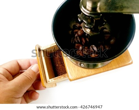 Coffee powder in open drawer of manual coffee grinder - stock photo