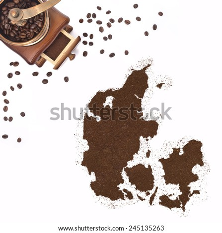 Coffee powder in the shape of Denmark and a decorative coffee mill.(series) - stock photo