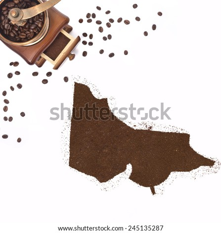 Coffee powder in the shape of Victoria and a decorative coffee mill.(series) - stock photo