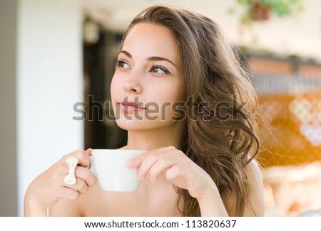Coffee romance, portrait of a gorgeous young brunette woman. - stock photo