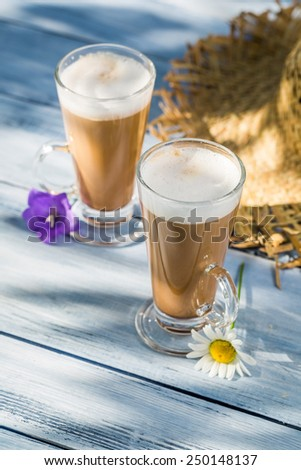 Coffee served in the sunny garden - stock photo