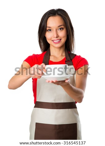 Coffee serving waitress. Young asian barista woman smiling showing cup of coffee. Isolated on white background. Focus on waitress. - stock photo