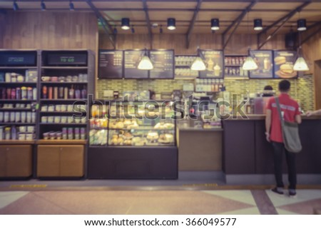 coffee shop blur background with bokeh image,in vintage effectCustomers enjoy coffee and delicious food. - stock photo