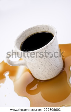 Coffee spilled on the table - stock photo