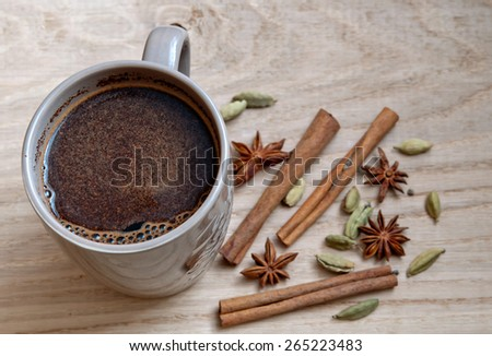 coffee, star anise, cinnamon stick and cardamom on a wooden background - stock photo