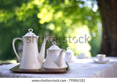 Coffee table in a garden - stock photo