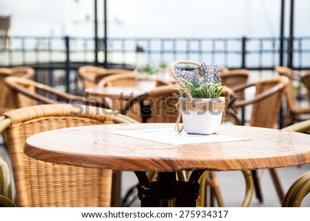 Coffee Table waiting for customers at an outdoor terrace in Netherlands - stock photo