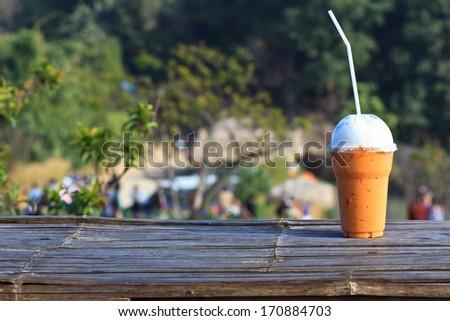 coffee tea on the wood garden table - stock photo