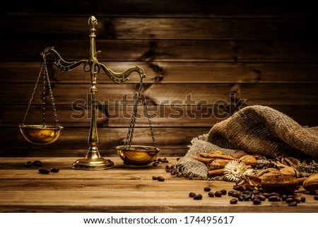 Coffee theme with brass scales still-life on wooden table  - stock photo