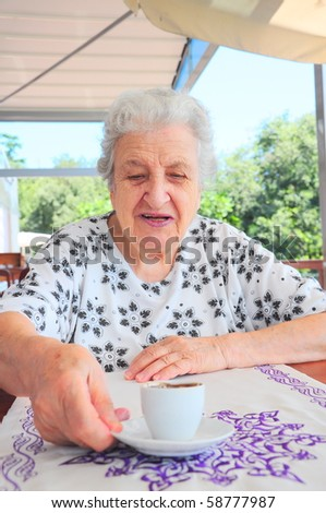 coffee time for senior woman - stock photo