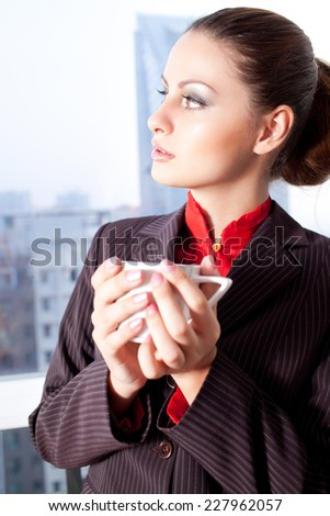 Coffee Time. Woman drinks some coffee - stock photo