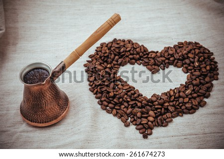 Coffee turk on burlap background. coffee beans isolated on white background. roasted coffee beans - stock photo