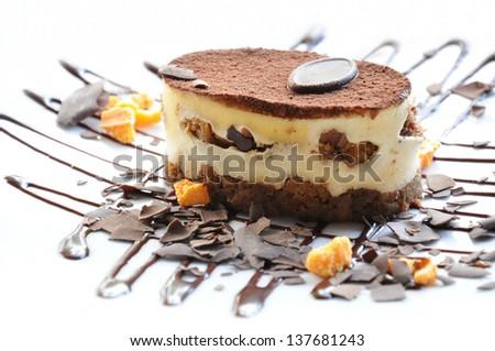 Coffee vanilla cake decorated with some chocolate - stock photo