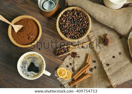 Coffee with beans and spices on wooden table, top view - stock photo
