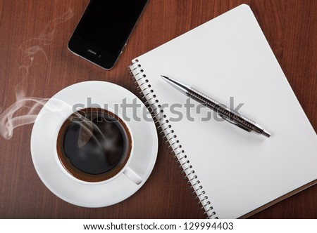 coffee with blank notebook and phone - stock photo