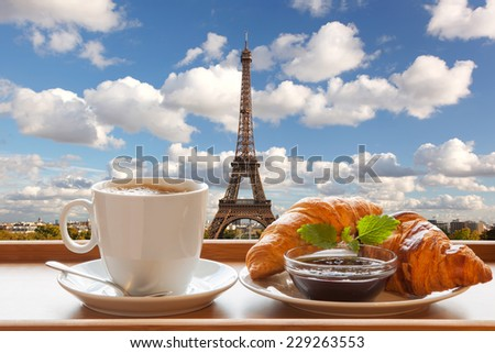 Coffee with croissants against Eiffel Tower in Paris, France - stock photo