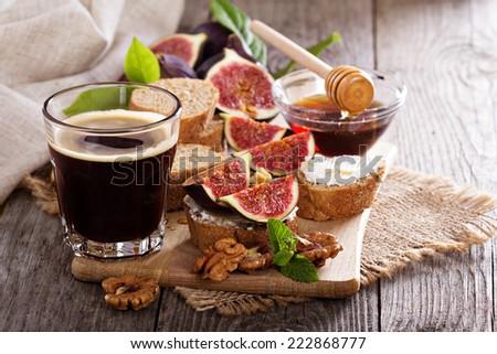 Coffee with figs, honey and cheese bruschetta - stock photo