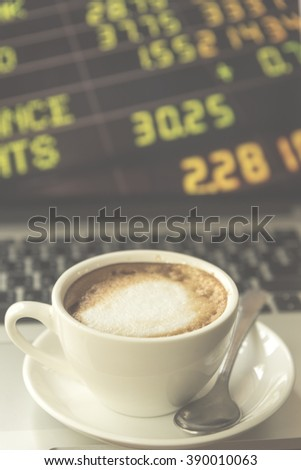 Coffee with the stock market to do business, vintage filtered Images - stock photo