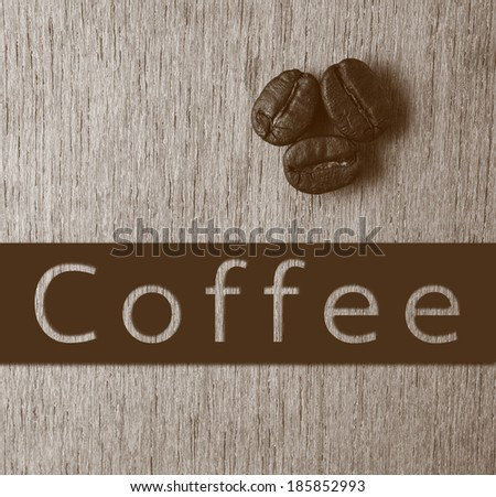 Coffee word with Roasted Coffee Beans on wood texture, monotone color background - stock photo