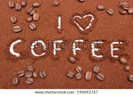 Coffee word written on ground coffee and coffee grains - stock photo