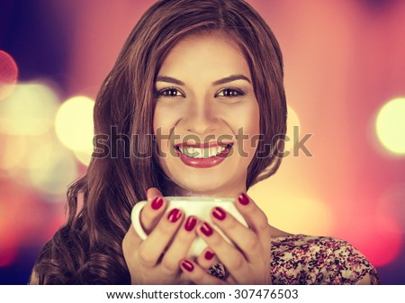 Coffee. Young beautiful Girl woman drinking Tea Cappuccino in trendy cafe shop. Beauty Model with Cup of Hot Beverage. Closeup portrait, warm colors. Human emotions positive facial expressions feeling - stock photo