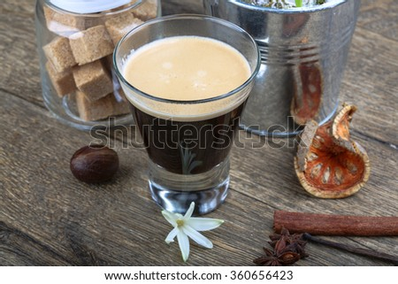 Coffeee Espresso in glass with beans, cinnamom - stock photo