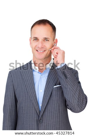 Cofident smiling businessman using headset against a white background - stock photo
