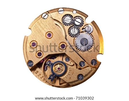 Cog wheels mechanics inside old watch - stock photo