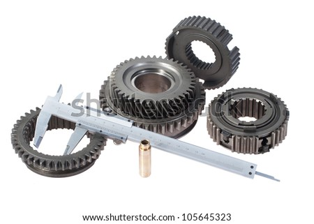 cog wheels with vernier calipers isolated on white background - stock photo