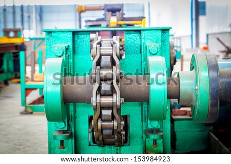 Cog wheels work with chain - stock photo