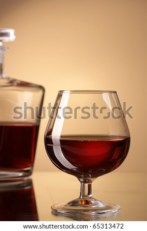 cognac glass and bottle - stock photo