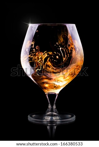 Cognac or brandy on a  black background - stock photo