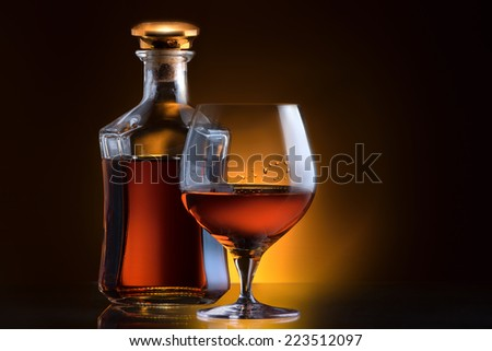 Cognac or brandy on a colored background - stock photo