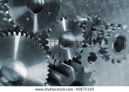 cogs and gears, titanium and steel, blue toning idea - stock photo