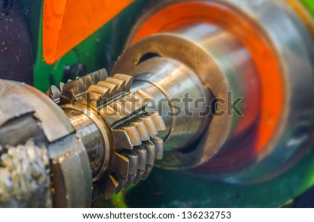 cogwheel  production and service industrial machine, rotating gears high view - stock photo