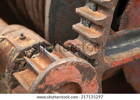 Cogwheels in an old machinery - stock photo