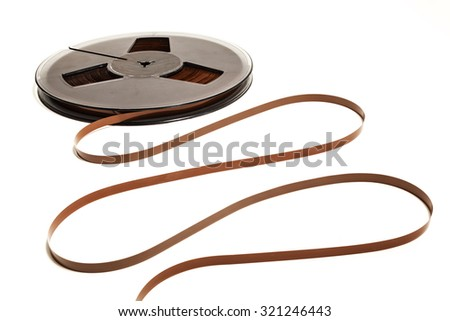 Coil with unwound movie tape. Obsolete technology - stock photo
