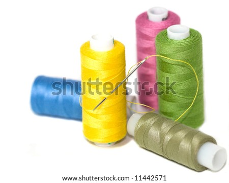 Coils of colour threads isolated on white - stock photo