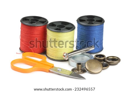 Coils threads and scissors on a white background - stock photo
