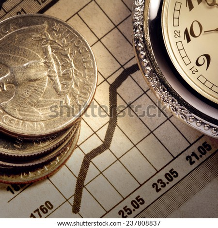 coin and clock on chart bussnes concept - stock photo