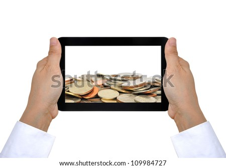 coin and touch pad PC on woman hand - stock photo